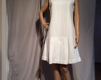 """Sleeveless drop Waist White texture midi dress, Fits like a Misses size 8, 15"""" accross shoulders and 36"""" from shoulder to Hemline"""