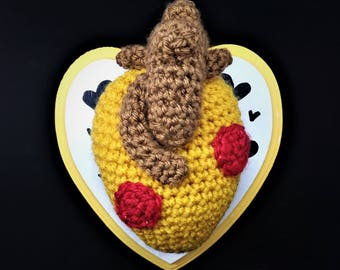Crocheted pizza anatomical heart mounted on heart shaped wall plaque