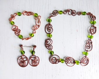 Copper jewelry set with green glass beads - necklace, bracelet and earrings