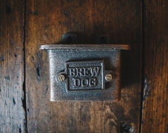 Vintage Style Wall Mounted Bottle Cap Catcher in an Antique Iron Finish (Brew Dog)