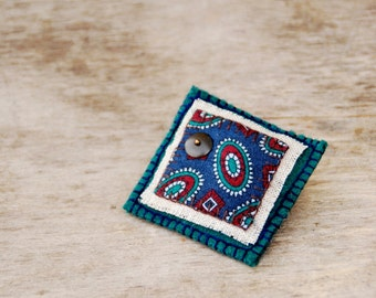 Handmade textile brooch. Floral teal, blue and green wool and cotton brooch.