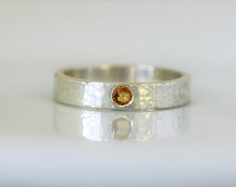Hammered 4mm wide sterling silver, ethical silver, recycled band woth 3mm orange sapphire.