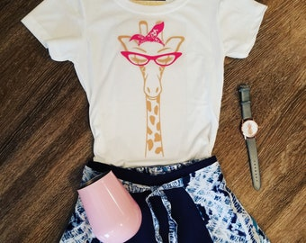 caramel giraffe with pink glases and bandana t-shirt