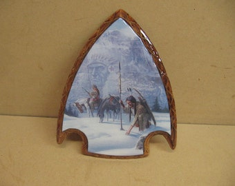 Trackers in the snow on a arrowhead frame