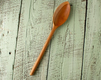 Wooden french tulip chalet style cooking spoon handmade in Vermont cherry with round handle and a beautifully grained two toned bowl.