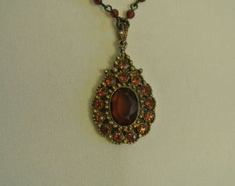 A Very Pretty Necklace With Dark Pink Stone