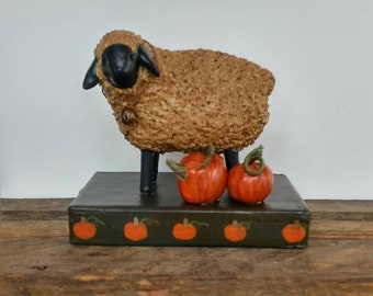 hand sculpted polymer sheep with pumpkins on painted base