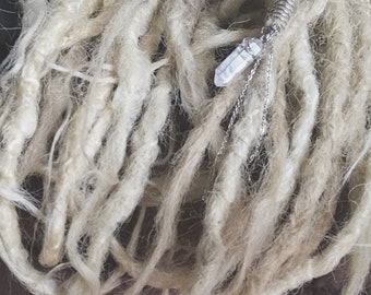 For dreadlocks made by hand with quartz crystal and stainless steel.