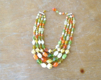 vintage fruit salad necklace, molded plastic bead strand . green, orange, yellow and clear 4 strand beaded necklace made in West Germany