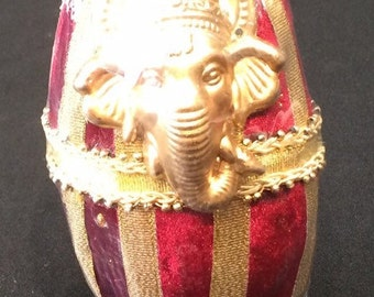 Red Decorated Coconut with Gold Ganesh