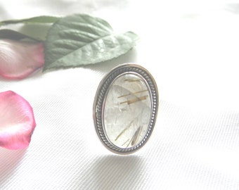 Silver ring with a rutilated Quartz stone