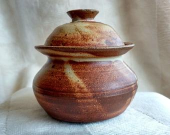 Small covered stoneware jar