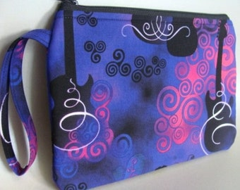 Wristlet Purse Wrist Strap Handbag Clutch made with Guitars Rock On Fabric Pink and Purple