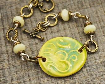 Om symbol bracelet, chartreuse green yellow, mixed metal brass and silver, lemon jade, 7 1/4 inches