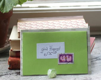 Good Happens! Apple green card with handwritten quote and birdie postal stamp