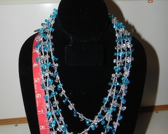 Vintage beaded Necklace; blue and clear Very Long, Hand Made?