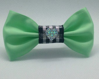 Green and black tartan heart bow.