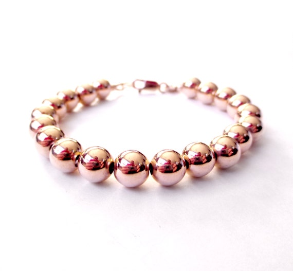 bracelet perle or rose