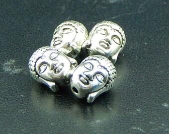 5 Buddha head beads