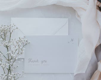 Dusty pink thank you card with delicate fonts