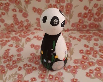 Ping the pretty panda, a classic peg doll perfect for role play here to spark your child's imagination