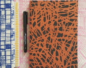 A5 sized hardback sketchbook in screen printed Copper Tropic fabric by Lucie Summers.