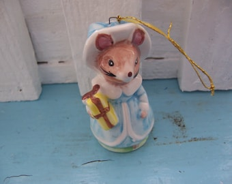 adorable rat with a yellow gift figurine