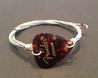 Recycled Guitar String Bracelet/Bangle: with a fender plectrum.