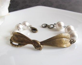 Dragonfly cuff bracelet. Brass Dragonfly. Ivory Swarovski pearls. Antiqued brass Nickel Lead free Bracelet. Spring Accessory