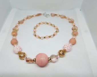Peach beaded necklace with free matching stretch bracelet