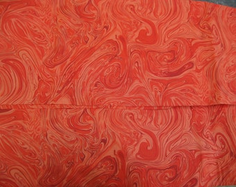 100 percent cotton marbled orange fabric/quilting/crafts/apparel/by the yard