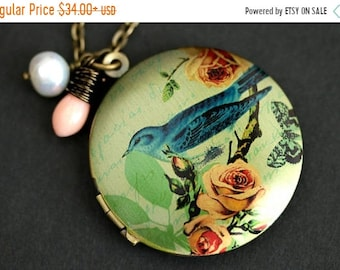 MOTHERS DAY SALE Blue Bird Locket Necklace. Bluebird Necklace. Bird Necklace with Pink Coral Teardrop and Pearl Charm. Bronze Locket. Photo