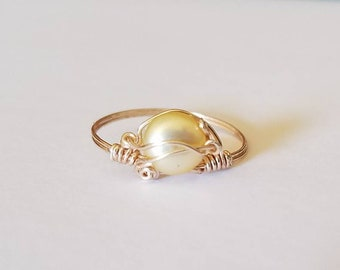 Rose gold wire with yellow freshwater pearl.