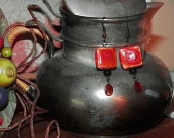 Stoneware Red beads/Swarovski Crystal Red Magma/Czech bead Black on Black Ear wire