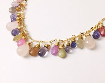 Mixed rainbow gemstone necklace with blue purple iolite, pink rose quartz and blue and brown sapphires