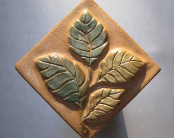 Birch Sprig Handmade Accent Tile Sculpted in Heavy Relief. Fired in Chocolate Brown Glaze.