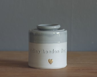 custom infant urn. gold infilled stamp, lid and quote, straight shaped urn with custom name. modern urn for ashes. funerary infant urn.