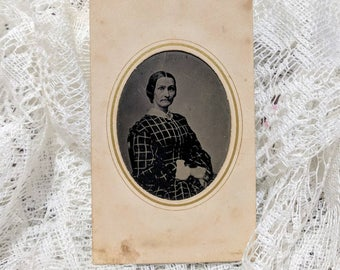Tintype photograph of a beautiful fashionably dressed woman in a paper frame wearing plaid