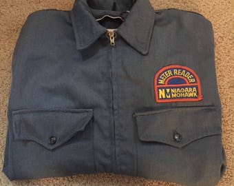Vintage 1960s New York State Niagara Mohawk Meter Reader jacket.Blue gray, in great condition. Mens size 38.