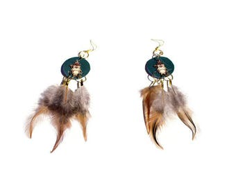 Dream catcher earrings adorned with 3 feathers and green leather