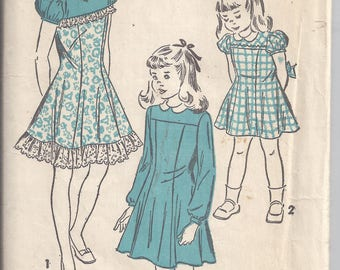 Advance 4879 Vintage Sewing Pattern from the 1940's; Girls Dress with yoked top.  Breast 26