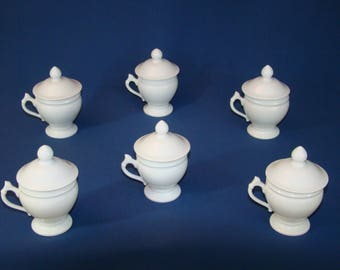 6 white porcelain cream jars