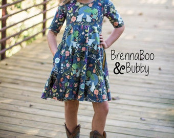 Islas Infinity knit/ woven tunic peplum and dress. PDF sewing pattern for toddler girl sizes 2t - 12.