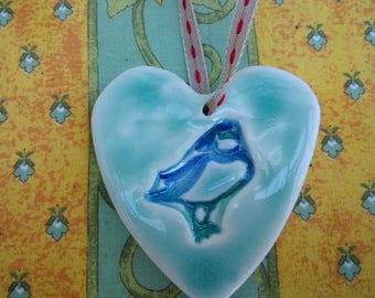 Porcelain heart with a Puffin