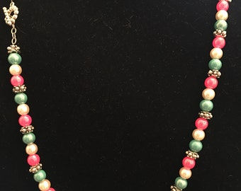 24 inch necklace in silver with pink, white, and blue pearls .