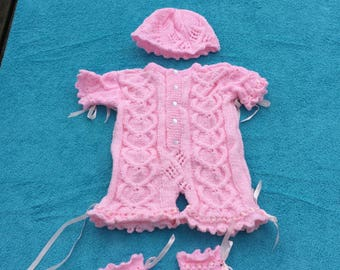 Beautiful hand knitted baby romper set