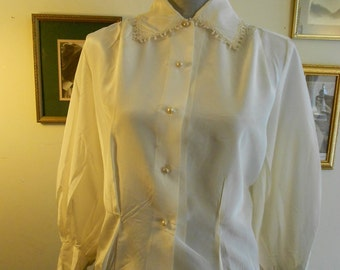 "1950's, 36"" bust, white rayon blouse, with wide pointed collar,"