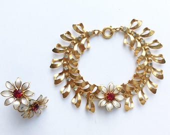 Beautiful Vintage Bugbee and Niles white enamel, red rhinestone, and gold tone bracelet and earring set