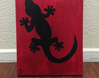 Black gecko on red
