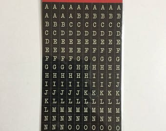 White letters alphabet stickers bottom black Pebbles